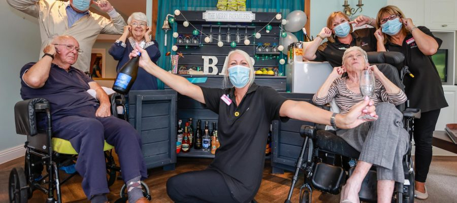 Residents at Encore Care Homes Fairmile Grange in Christchurch celebrated the opening of their new bar The Merry Fairmilers after money was raised from a sponsored silence by Kim Butters, Wellbeing Manager